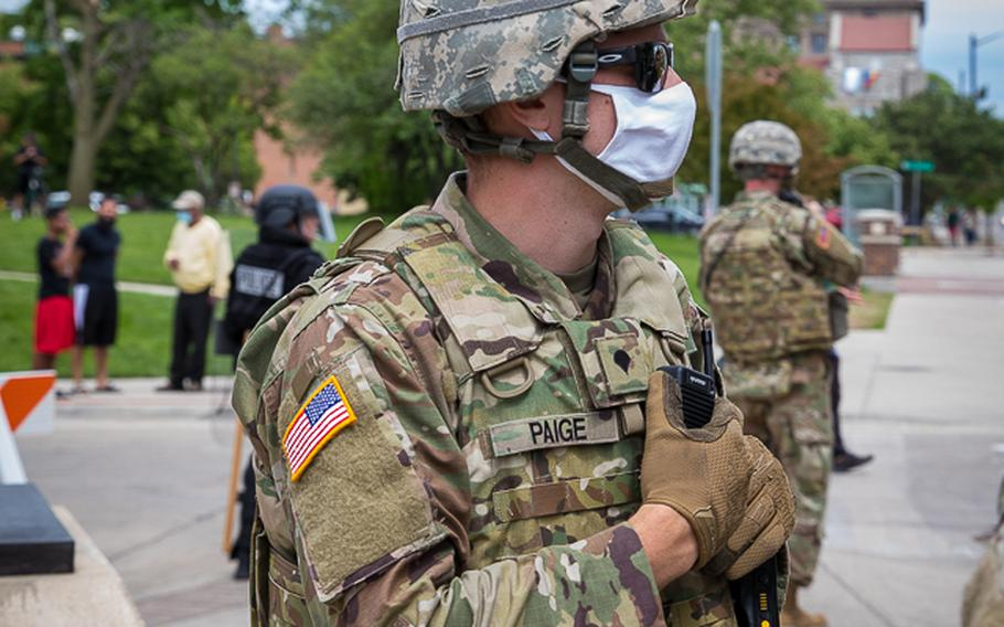 Military police from the Michigan National Guard work in Grand Rapids on June 1, 2020, to ensure peace during a protest downtown.