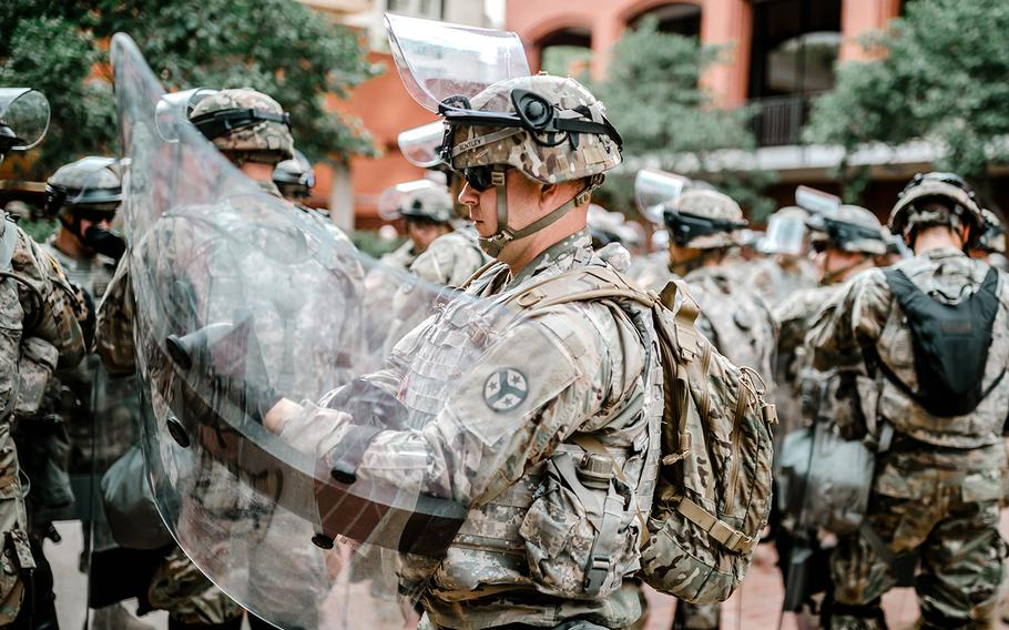 Soldiers from the 278th Armored Cavalry Regiment of the Tennessee Army National Guard stand ready to support police and first responders in Washington, D.C., on Saturday, June 6, 2020.