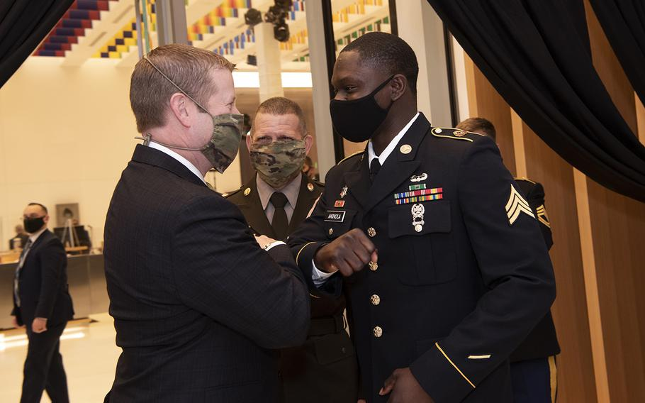 Army Secretary Ryan D. McCarthy greets the 2020 Soldier of the Year, Sgt. James Akinola, at the opening of the National Museum of the United States Army, Fort Belvoir, Va., on Nov. 11, 2020.