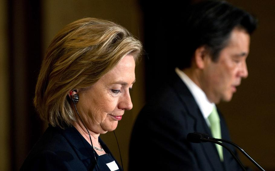 Japanese Foreign Minister Katsuya Okada, right, and U.S. Secretary of State Hillary Rodham Clinton hold a joint press conference May 21 following meetings at the Iikura Guest House in Tokyo.