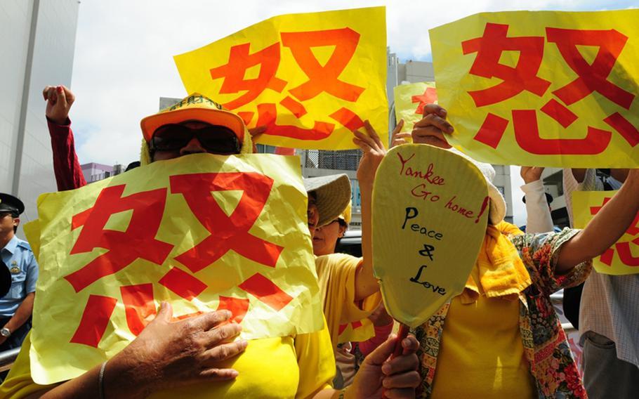 Protesters express anti-base sentiments as Japanese Prime Minister Yukio Hatoyama meets with Okinawa Gov. Hirokazu Nakaima in 2010.