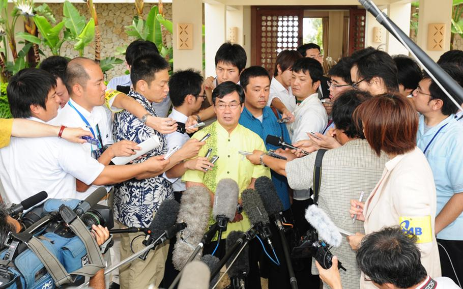 Mayor Susumu Inamine of Nago, where Camp Schwab is located, talks to reporters after a meeting with Prime Minister Yukio Hatoyama at the Busena Resort Conference Center in Nago on Sunday. He told reporters, that the mayors were united in their resolve to continue fighting against the relocation of Marine Corps Air Station Futenma.