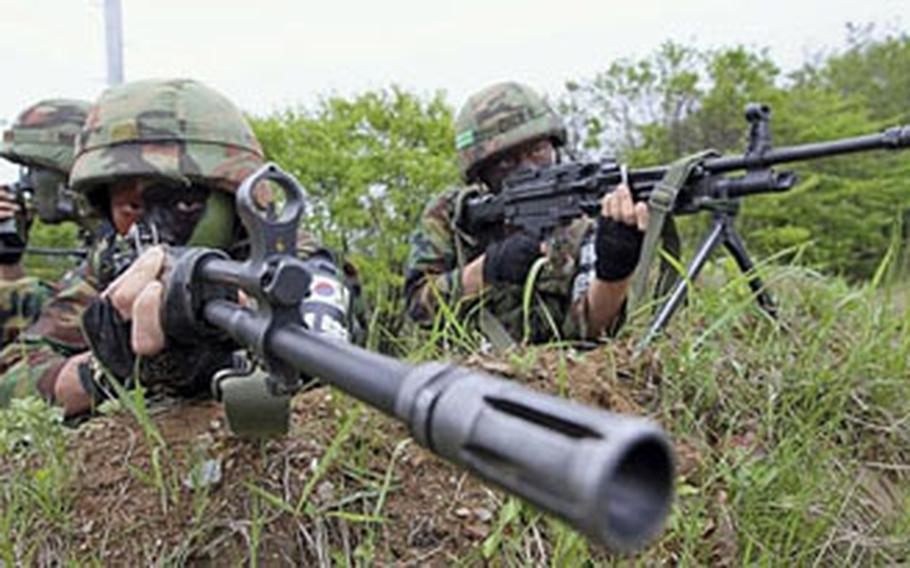 South Korean artillery soldiers take positions during an exercise against possible North Korean attacks, in Paju, South Korea, near the demilitarized zone between the two Koreas, Monday. South Korean artillery soldiers take positions during an exercise against possible North Korean attacks, in Paju, South Korea, near the demilitarized zone between the two Koreas, Monday.