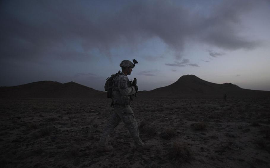 United States Army Staff Sgt. Rande Henderson of Helena, Mont., sets out at dusk with members of 2nd Platoon, Charlie Company, 1st Battalion, 17th Infantry Regiment of the 5th Stryker Brigade to set up an ambush for Taliban fighters Friday, May 21, 2010, in Afghanistan's Kandahar province.