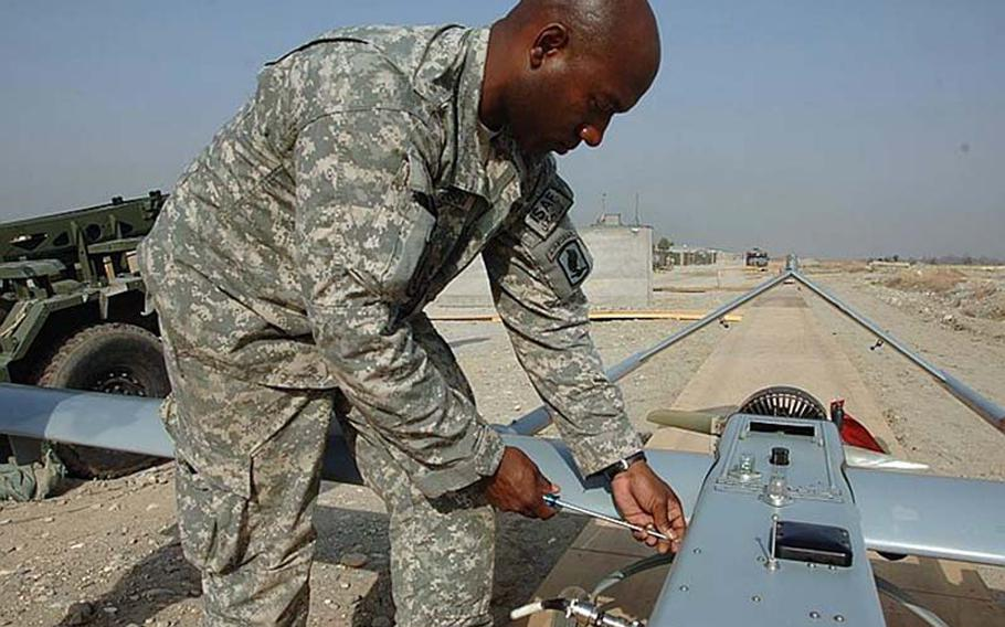 U.S. Army Staff Sgt. Alton Jefferson, from Bravo Company, 173rd Special Troops Battalion, prepares an RQ-7 Shadow unmanned aerial vehicle for launch from Forward Operating Base Fenty in Jalalabad, Afghanistan, March 17, 2008.