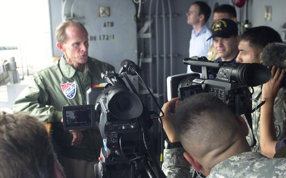 Adm. Dan Cloyd, commander of Task Force 70 and the man in charge of the U.S. part of the Invincible Spirit exercise now underway off the east coast of South Korea, is interviewed Sunday by some of the 11 journalists on board the USS George Washington.