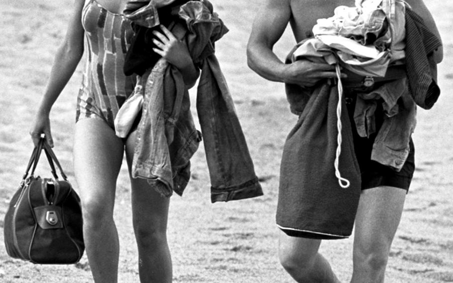 """Hayley Mills and James MacArthur walk along the beach on Spain's Costa Brava during the filming of """"The Truth about Spring"""" in 1964."""