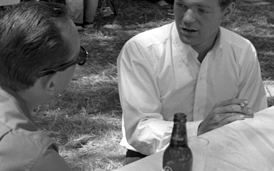 """James MacArthur is interviewed by Stars and Stripes' Wallace Beene during the filming of """"The Truth about Spring."""""""