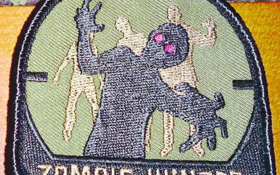 """It's not official Army gear, but a """"Zombie Hunter"""" patch captures the spirit of a tongue-in-cheek defensive plan developed for the base at Spin Boldak, Afghanistan."""