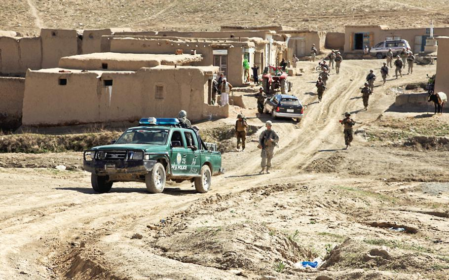 Soldiers of the 1st Squadron, 91st Cavalry Regiment, and members of the Afghan National Army and Afghan National Police patrol a bazaar on their way into the village of Bakshikhala, Kherwar district, Logar province, in April. The unit returned to Schweinfurt, Germany, in November after a third deployment in Afghanistan.