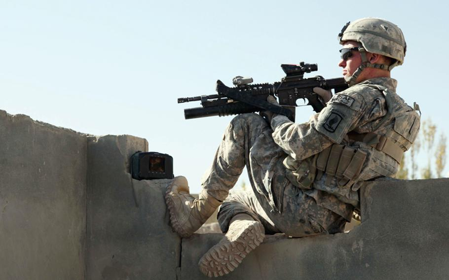 U.S. Army Pvt. David Stufflebeam, from 1st Squadron, 91st Cavalry Regiment, 173rd Airborne Brigade Combat Team, provides security during a mission to deliver a swing set to the village of Manghokhel in the Kherwar district of the Logar province of Afghanistan on Oct. 8, 2010.