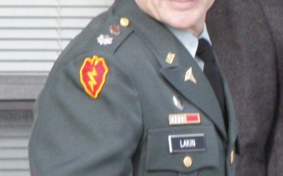 Lt. Col. Terrence Lakin leaves the courthouse at Fort Meade, Md., during the first day of his court-martial Tuesday. Lakin refused to deploy to Afghanistan last spring, claiming that the order was not valid because Barack Obama's presidency may not be legitimate due to claims he is not an American-born citizen.