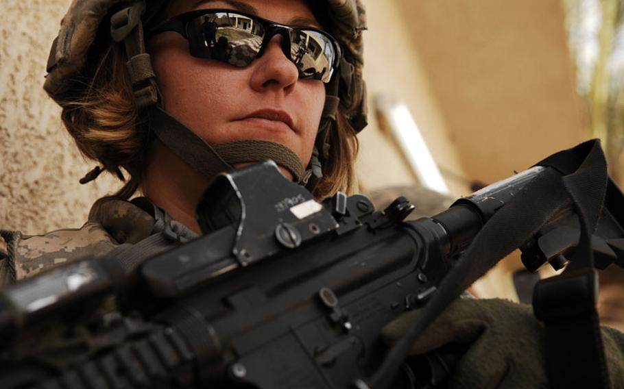U.S. Army Spc. Rebecca Buck, a medic from Headquarters and Headquarters Company, 1st Battalion, 14th Infantry Regiment, 2nd Stryker Brigade Combat Team, 25th Infantry Division, provides perimeter security outside an Iraqi police station in the Tarmiya Province of Iraq, March 30, 2008.