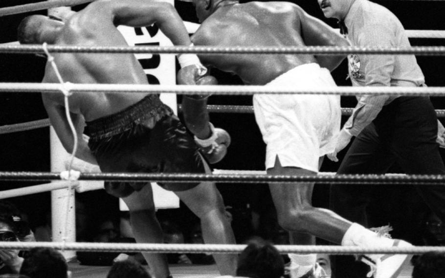 """James """"Buster"""" Douglas finishes off Mike Tyson in the 10th round of their fight at the Tokyo Dome."""