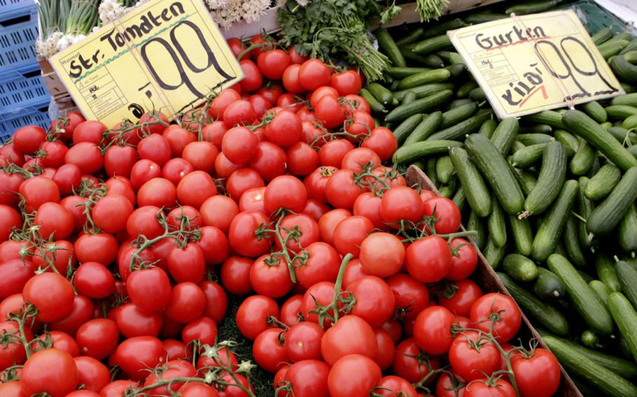 Tomatoes and cucumbers from Holland are displayed for sale Friday at a market in Berlin, Germany.