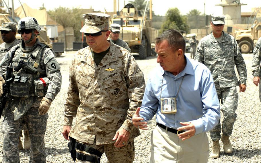 Lt. Gen. John Allen, center, speaks with a member of a Provincial Reconstruction Team 6 in Iraq. Allen was selected to succeed Gen. David Petraeus as the commander of the Afghanistan war.