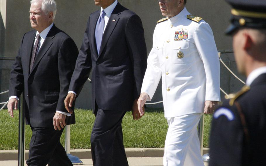 Outgoing Defense Secretary Robert Gates, President Barack Obama and Adm. Mike Mullen, chairman of the Joint Chiefs of Staff, at a Pentagon ceremony Thursday honoring Gates' time in office.