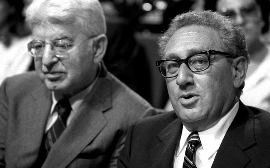 Former Secretary of State Henry Kissinger and U.S. Ambassador Arthur Burns at Worms, Germany, in 1983.