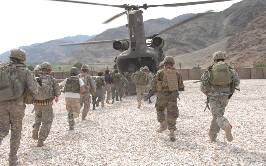 U.S. Army Soldiers, 2nd Battalion, 503rd Infantry Regiment, 173rd Airborne Brigade, the Afghan National army soldiers, and the Afghan Border Patrol conduct training on how to enter and exit a CH-47 Chinook helicopter at Forward Operating Base Fortress, Konar Province, Afghanistan, April 11, 2008, in preparation for operation Rock Tempest.