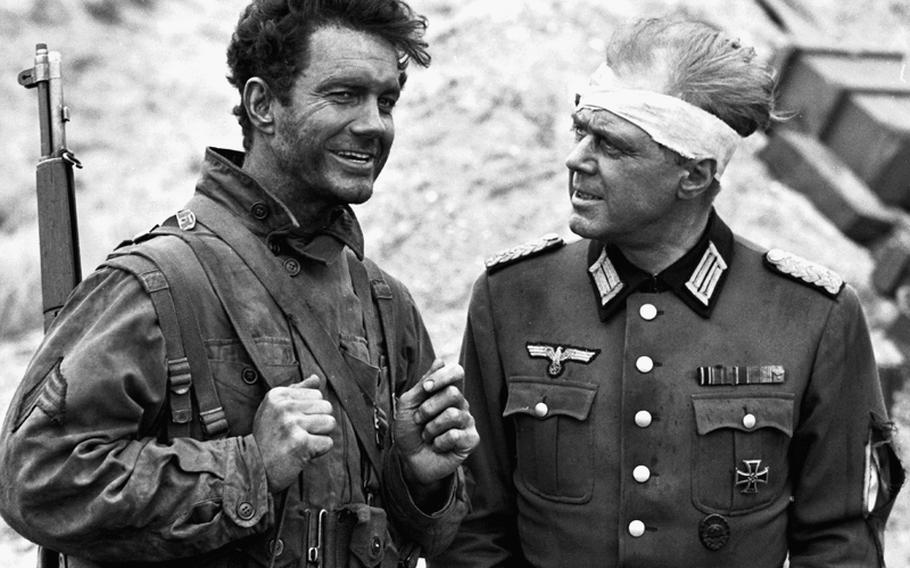 """Cliff Robertson with British actor Marius Goring, who was playing a captured German officer in """"Up from the Beach."""""""