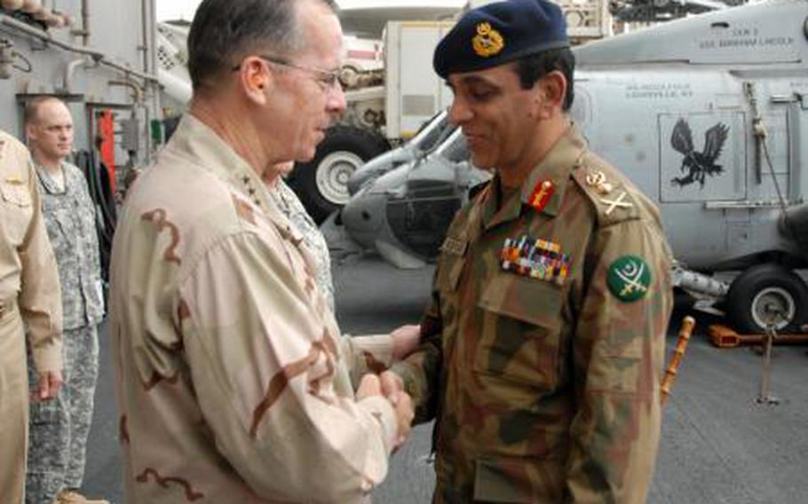 Adm. Mike Mullen, chairman of the Joint Chiefs of Staff, greets Pakistani Chief of Army Staff, Gen. Ashfaq Kayani, after arriving aboard the aircraft carrier USS Abraham Lincoln in 2008.