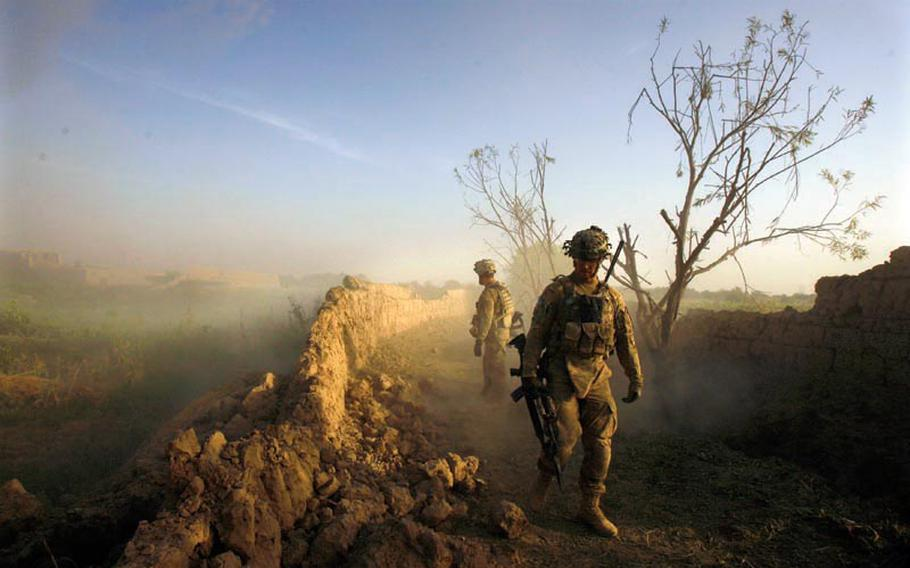 Platoon Leader 2nd Lt. Timothy Gonski, front, and Sgt. Frank Iannaccone of Company C, 1st Battalion, 32 Infantry Regiment, 3rd Brigade Combat Team, 10th Mountain Division, front, inspect a wall after blowing an anti-personnel obstacle breaching system during Operation Steel Lion III on August 27, 2011, at Strong Point Alizi in Kandahar Province, Afghanistan.