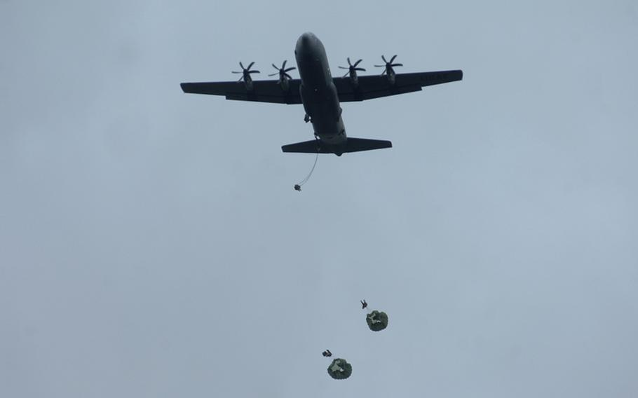 A C-130 releases paratroops during a morning jump at the Hohenfels training area on Wednesday, part of a month-long exercise. Twenty-five soldiers were transported to the hospital with injuries following the jump.