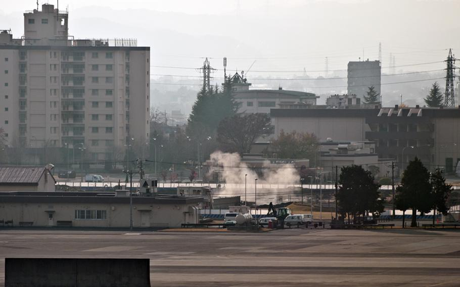 Dust begins to settle after the explosion of the 110-pound bomb at Yokota Air Base, Japan on Dec. 7, 2011.