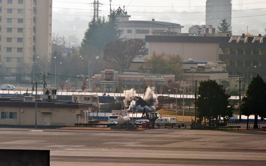 Dirt and smoke fly into the air as a 110-pound bomb is detonated Dec. 7, 2011, at Yokota Air Base, Japan.