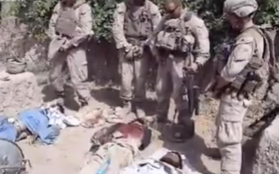 The Marine Corps launched an investigation after a video posted on YouTube showed several Marines laughing and appearing to urinate on the bodies of dead insurgents.