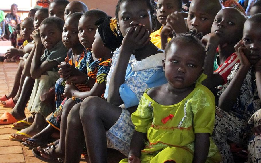 Children sit up front at a January, 2012 Catholic church service in Obo, Central African Republic, where U.S. special operations forces assisted in a mission against the Lord's Resistance Army rebel group.