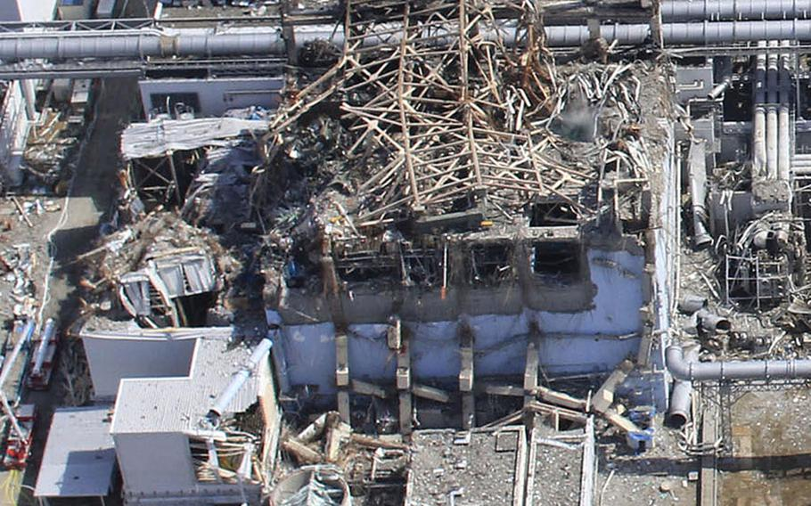 This handout aerial photo dated March 20, 2011, taken by small unmanned drone shows damaged Unit 4, left, and Unit 3 of the crippled Fukushima Daiichi nuclear power plant in Okumamachi, Fukushima prefecture, northern Japan.
