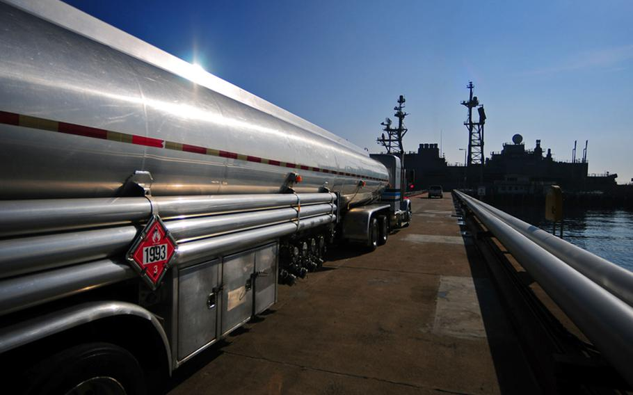 A fuel tanker truck filled with biofuel moves into position to begin fueling the decommissioned Spruance-class destroyer self defense test ship USS Paul F. Foster on the fuel pier at Naval Base Point Loma in November, 2011.