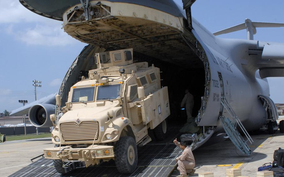 A Mine Resistant Ambush Protected vehicle rolls off a C-5 Galaxy at Osan Air Base, South Korea, on July 7, 2012. Five MRAPs were flown to Osan then delivered to the 2nd Infantry Division, which will test the vehicles to see how they might be used by American troops on the Korean peninsula.