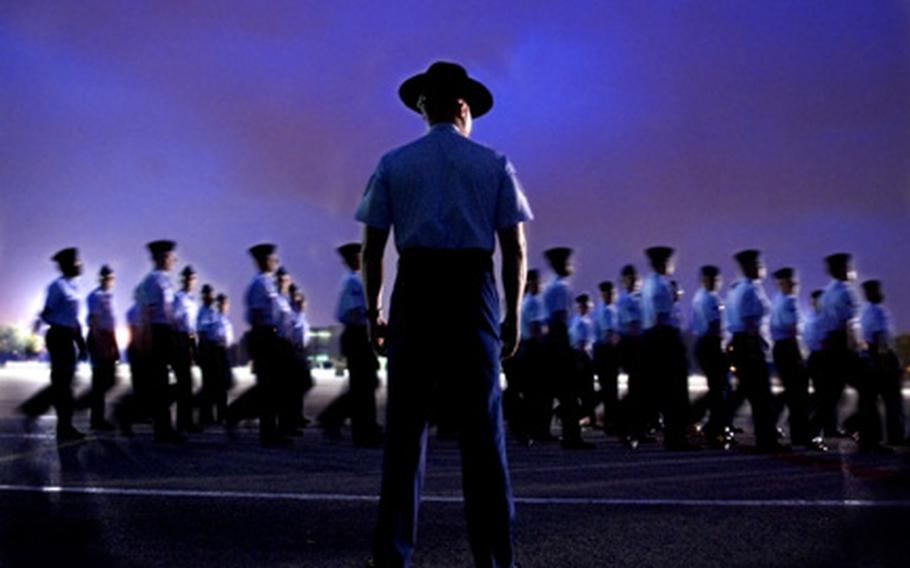 A group of basic trainees perform formation and parade drills in preparation of their graduation on Lackland Air Force Base, Texas.