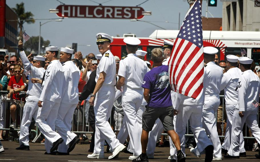 Dozens of U.S. Navy personnel from ships based in San Diego acknowledge the crowd lining the city's Hillcrest neighborhood during the annual LGBT Pride parade on July 21, 2012.