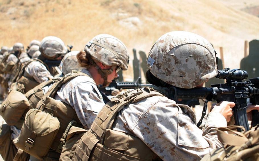 Marines with a Female Engagement Team fire at paper targets during a combat marksmanship training exercise at Camp Pendleton.