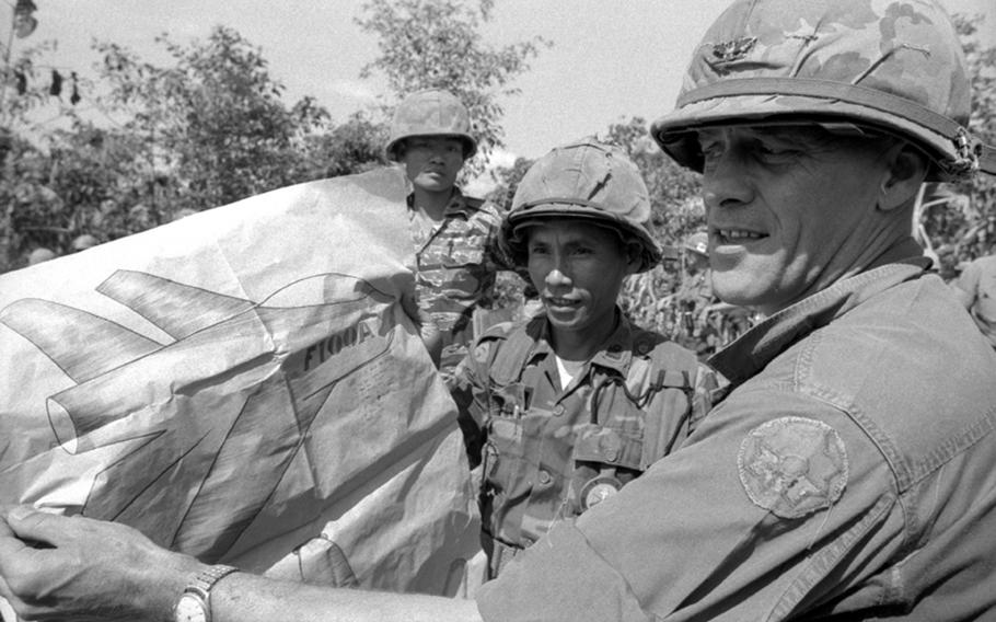 American and South Vietnamese officers display a captured Viet Cong drawing of a U.S. aircraft.