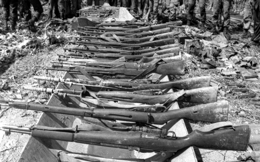 Weapons captured from Viet Cong troops during the battle are displayed.