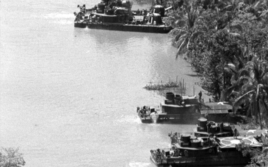 Boats are beached near where Americans from the 9th Infantry Division's 2nd Brigade Riverine Force and South Vietnamese from the 5th Vietnamese Marine Battalion battled the Viet Cong along the My Tho River, 65 miles southwest of Saigon.