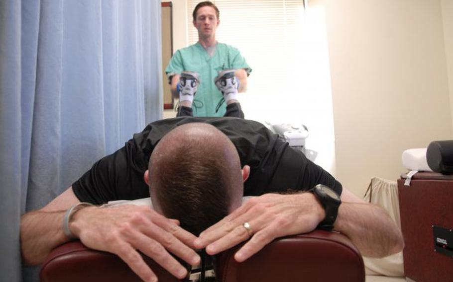 Dr. Aaron Harris, chiropractic physician with William Beaumont Army Medical Center, performs an adjustment on Col. James Ryan, 15th Sustainment Brigade, at the Center for Integrative Medicine on Fort Bliss.