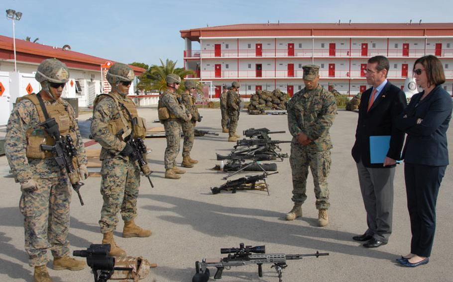 Marines assigned to Fleet Antiterrorism Security Team Company Europe brief U.S. ambassador to Spain and Andorra Alan Solomont on some of the weapons that are used while deployed during a visit to Naval Station Rota, Spain in this March 2012 photo.