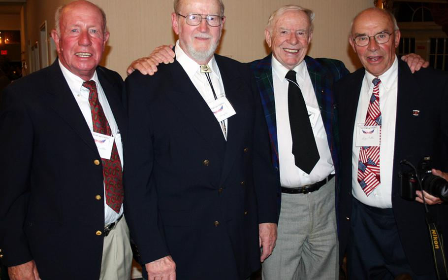 Gus Schuettler, left, at a 2005 Stars and Stripes reunion with fellow photographers Frank Praytor, Red Grandy and Roger Ruhlin.