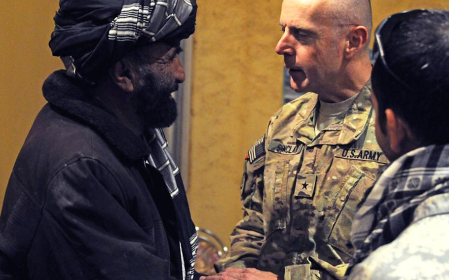 Brig. Gen. Jeffrey A. Sinclair greets an Afghan leader before the Combined Team Zabul Winter Operations Back Brief for American and Afghan key leaders at Forward Operating Base Eagle, Nov. 16. 2011.