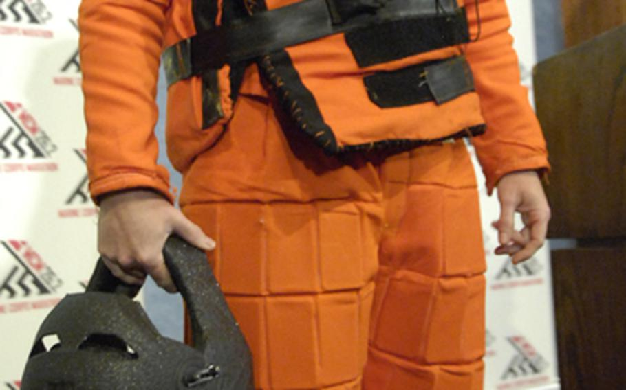 """Dr. Travis Taylor of National Geographic Channel's """"Rocket City Redneck,"""" in the experimental protective suit he'll wear in the 2012 Marine Corps Marathon."""