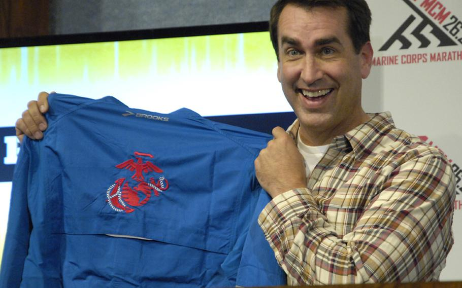 Actor and comedian Rob Riggle, a Marine Corps lieutenant colonel, displays the jacket he received in his role as starter for the 2012 Marine Corps Marathon.