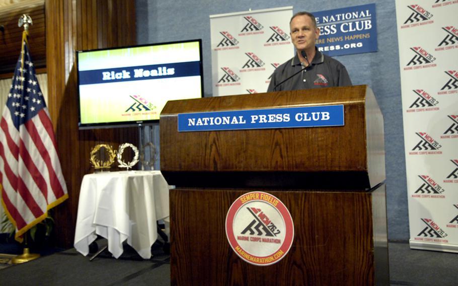 Marine Corps Marathon Race Director Rick Nealis talks to the press.