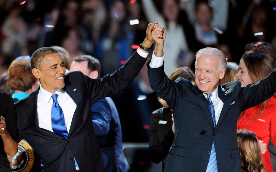 President Barack Obama and Vice President Joe Biden on stage in Chicago after being re-elected to a second term.
