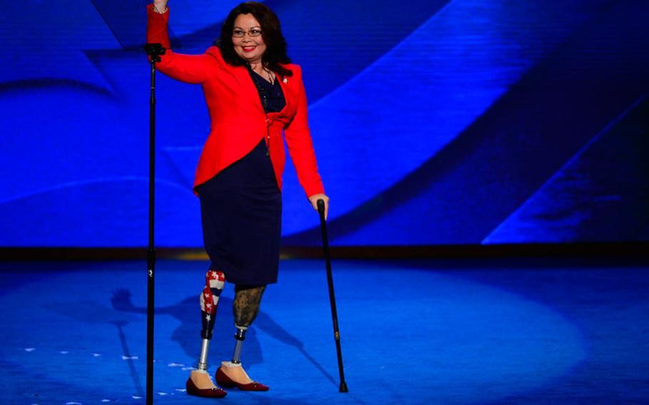 Congressional candidate Tammy Duckworth of Illinois waves as she leaves the stage after speaking at the 2012 Democratic National Convention at the Time Warner Cable Arena in Charlotte, North Carolina, Tuesday, September 4, 2012.