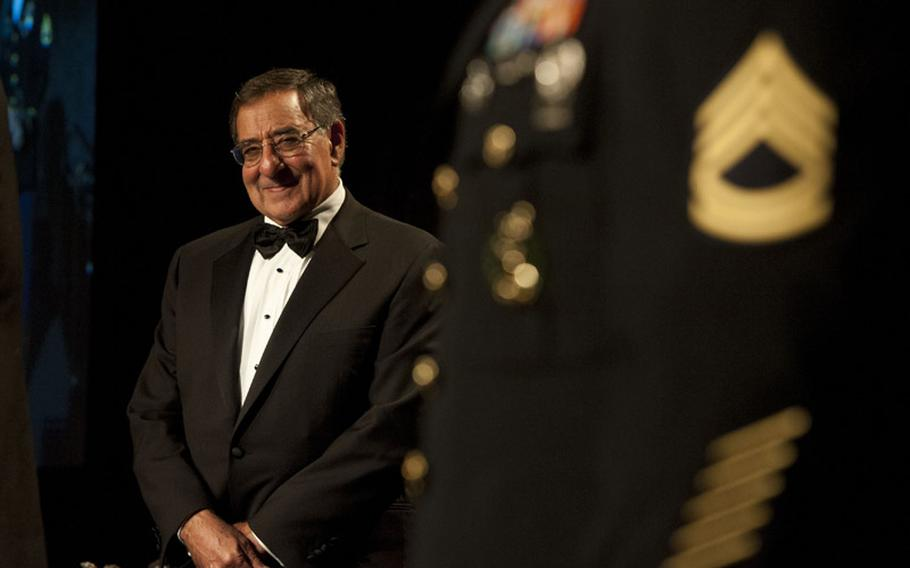 Secretary of Defense Leon E. Panetta watches as U.S. Army personnel are honored during the Business Executives for National Security 2012 Eisenhower Award dinner in New York City Oct. 11, 2012.